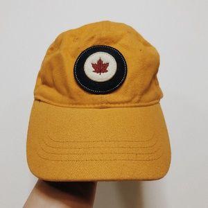• RED CANOE CANADA • mustard yellow hat